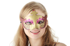 Young woman wearing carnival mask Stock Images