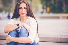 Young woman, wearing casual clothes, with long hair Royalty Free Stock Image