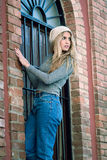 Young woman wearing casual clothes smiling in urban background Royalty Free Stock Photos