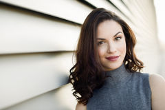 Young woman wearing casual clothes in urban background Royalty Free Stock Photo