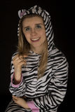 Young woman wearing cat pajamas playing with her hair Stock Photography