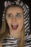 Young woman wearing cat pajamas surprised facial expression Stock Photos