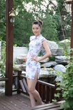 Young woman wearing cheongsam Stock Images
