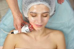 Young woman wearing collagen mask. Royalty Free Stock Image
