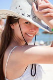 Young woman wearing a cowboys hat. Happy young woman wearing a cowboys hat at the beach stock image