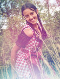 Young woman wearing dirndl posing in the field Stock Photo