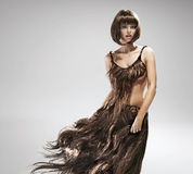 Young woman wearing dress made of hair Stock Images