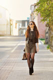 Young woman wearing dress and walking on the Royalty Free Stock Photos