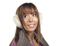 Young woman wearing ear muffs and scarf Royalty Free Stock Photography