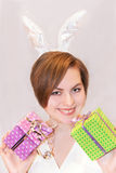 Young woman wearing easter bunny ears. Royalty Free Stock Image