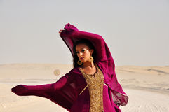 Young woman wearing eastern dress in arabic desert Stock Images