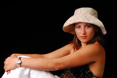 Young woman wearing an elegant hat Stock Images