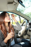 Young woman wearing eyeliner in the car Royalty Free Stock Photo