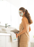 Young woman wearing facial cosmetic mask Royalty Free Stock Photography