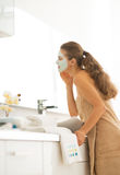 Young woman wearing facial cosmetic mask Royalty Free Stock Image