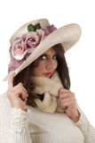 Young woman wearing fancy hat; isolated. Young woman wearing a fancy mauve and cream organdy hat; isolated on a white background Royalty Free Stock Image