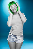 Young Woman Wearing Fashion Shades and Headphone Royalty Free Stock Images