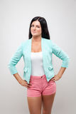 Young woman wearing a fashionable jackett and pink shorts Royalty Free Stock Image