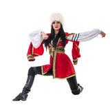 Young woman wearing a folk costumes dancing. Isolated on white background in full length with copyspace Royalty Free Stock Photos