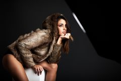 Young woman wearing a fur coat stock photo