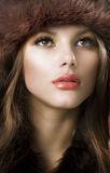 Young Woman wearing Fur Hat Royalty Free Stock Image