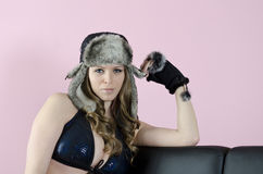 Beautiful eyes. Young woman wearing a fur hat Royalty Free Stock Image