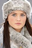 Young Woman Wearing Fur Hat And Wrap Royalty Free Stock Photos