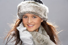 Young Woman Wearing Fur Hat And Wrap. Studio Portrait Of Young Woman Wearing Fur Hat And Wrap Royalty Free Stock Photo