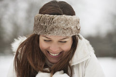 A young woman wearing a fur headband trying to keep warm in the snow Royalty Free Stock Photography