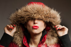 Young woman wearing furry hood Stock Photos
