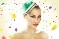 Young woman wearing gift-hat Royalty Free Stock Photos