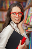 Young Woman Wearing Glasses And Holding A Book Stock Photography