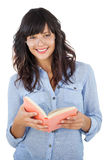 Young woman wearing glasses and holding book Stock Photo