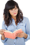 Young woman wearing glasses and thinking about her book Stock Image