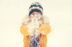 Young Woman wearing gloves playing with snow outdoor Winter vacations Stock Images
