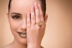 The young woman wearing golden ring. Young woman wearing golden ring Stock Photography