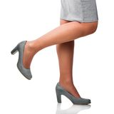 Young woman wearing gray shoes. Stock Photography