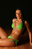 Young woman wearing green bikini Royalty Free Stock Images