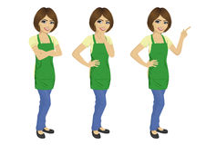 Young woman wearing green upron standing in different poses Royalty Free Stock Images