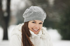 A young woman wearing a grey woolen beret, smiling Royalty Free Stock Photo