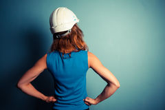 Young woman wearing hard hat Royalty Free Stock Image