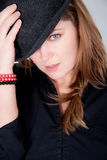 Young woman is wearing a hat Stock Photography