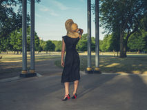 Young woman wearing hat at bandstand in park Royalty Free Stock Photography
