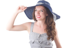 Young woman wearing hat and gray striped dress Stock Images