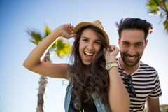 Young woman wearing hat and her boyfriend laughing. Front portrait of young women wearing hat and her boyfriend laughing Stock Image