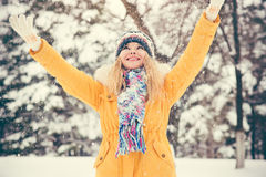 Young Woman wearing hat and scarf happy smiling Stock Image