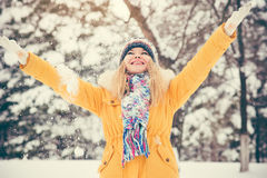 Young Woman wearing hat and scarf happy smiling Royalty Free Stock Photos