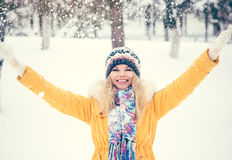 Young Woman wearing hat and scarf happy smiling hands raised outdoor Stock Photos
