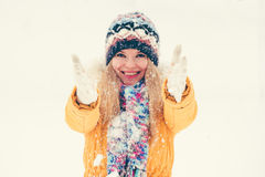 Young Woman wearing hat and scarf happy smiling playing with snow outdoor Royalty Free Stock Photos