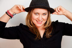 Young woman is wearing a hat and smiles royalty free stock photos
